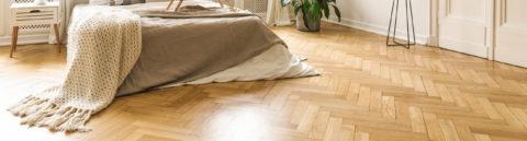 Sanded wooden floor of a bedroom