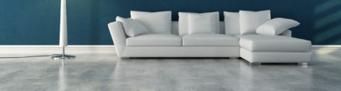 Polished concrete floor with modern white sofa